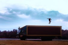 Free Brown Truck With Man With Skateboard On Top Royalty Free Stock Image - 116695666