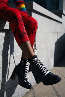 Free Person Wearing Chunky Heeled Laceup Boots Royalty Free Stock Photo - 116695685