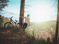 Free Man Holding Tree Enjoying The View Mountain Royalty Free Stock Photography - 116695697