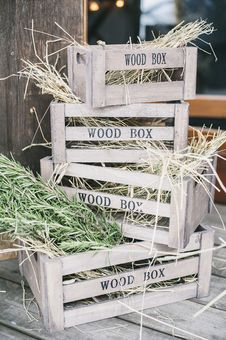 Free Four Stacks Of Brown Wooden Crates With Hays Stock Image - 116695741