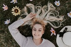 Free Woman Lying On Flowers Stock Images - 116695744