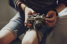 Free Person Holding Black And Gray Dslr Camera Royalty Free Stock Images - 116695749
