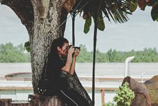 Free Woman Taking Photo Near To Tree Stock Images - 116695784