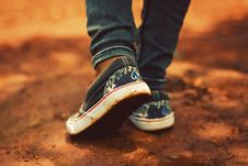 Free Person Wearing Black Low-top Sneakers And Black Jeans Stock Image - 116695801