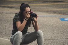 Free Woman In Gray Pants Sitting While Taking Photo Stock Photo - 116695880
