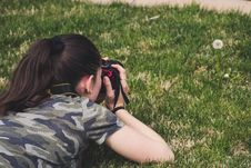 Free Photo Of Woman Taking Photo Of Flower On Grass Royalty Free Stock Image - 116695976