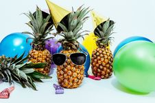 Free Photo Of Three Pineapples Surrounded By Balloons Stock Photography - 116696002