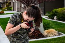 Free Woman Taking A Picture Of Floor Using Nikon Camera Royalty Free Stock Photo - 116696095