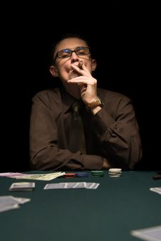 Smoker At The Poker Table Royalty Free Stock Photos