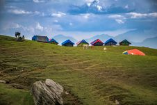 Free Photographed Of Lined Tents On Green Grass Hills Royalty Free Stock Photos - 116776188