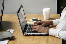 Free Person Wearing White Long-sleeved Top Using Laptop Computer Stock Photography - 116776302