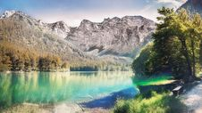 Free Landscape Photo Of Calm Body Water Between Trees And Mountain Royalty Free Stock Photos - 116776328