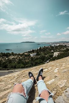 Free Man In Blue Tattered Jeans Sitting On Top Of The Mountain Stock Images - 116776344