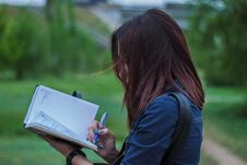 Free Close-Up Photography Of A Person Writing On Notebook Stock Photo - 116776440
