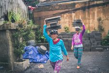 Free Photography Of Women Carrying Cinder Blocks Royalty Free Stock Image - 116776456