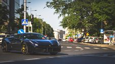Free Photography Of Black Ferrari On Roadway Stock Photo - 116776610