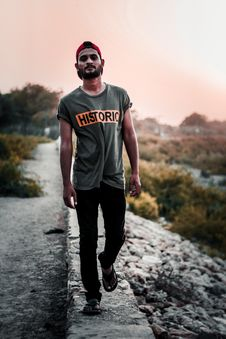 Free Man In Gray Shirt Standing On Concrete Pathway Stock Photography - 116853882