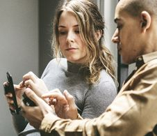 Free Two People In A Discussion With Mobile Phones Stock Images - 116853904