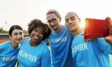 Free Group Of People Wearing Blue Volunteer Shirts Stock Images - 116853954