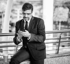 Free Greyscale Photo Of Man Wearing Suit Jacket And Eyeglasses Holding Smartphone Royalty Free Stock Photography - 116853987