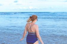 Free Woman Wearing Blue Monokini Standing Beside Body Of Water Under Blue Sky Stock Photo - 116854010