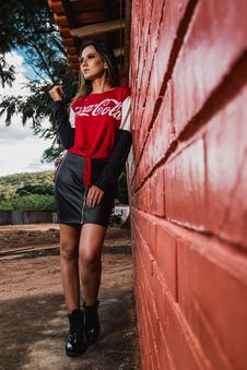 Free Woman Leaning On Wall Wearing Coca-cola Printed Top Stock Photography - 116854252
