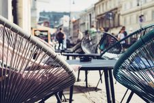Free Selective Focus Photography Of Patio Set Near Walking People Royalty Free Stock Photos - 116854288