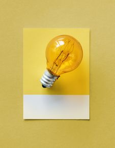 Free Brown Light Bulb Photo On Yellow Surface Stock Photography - 116854322