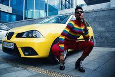 Free Woman Wearing Red Leggings Beside Yellow Car Royalty Free Stock Photos - 116927698