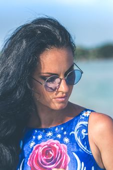 Free Shallow Focus Photography Of Woman Wearing Blue Floral Sleeveless Top And Black Sunglasses With Gray Frames Stock Image - 116927751