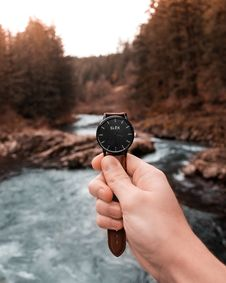 Free Person Holding Analog Watch Displaying 3:36 Stock Images - 116927784