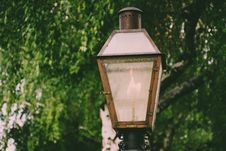 Free Lighted Brown Metal Post Lamp Royalty Free Stock Image - 116927796