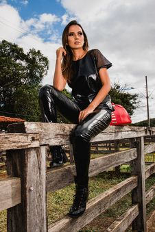 Free Woman Wearing Black Suit On Farm Sitting On Fence Royalty Free Stock Photography - 116927827