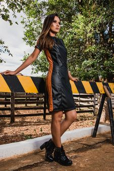Free Woman Wearing Black And Brown Leather Midi Dress And Black Chunky Heeled Boots Royalty Free Stock Photo - 116927835