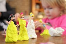 Free Selective Focus Photography Of Three Disney Princesses Figurines On Brown Surface Stock Images - 116927984