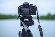 Free Selective Focus Photo Of Black Canon Camera On Tripod Stand In Front Of Body Of Water Photo Royalty Free Stock Image - 116927996