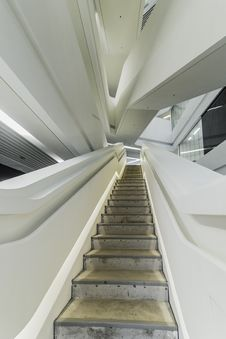 Free Brown And Gray Stairs With White Rails Stock Images - 116984384