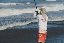 Free Person Holding Fishing Rod On Beach Stock Photography - 116984392