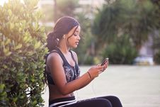 Free Woman In Black Crop Top Holding Smartphone Royalty Free Stock Photo - 116984405