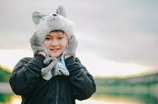 Free Boy Wearing Gray Dog Critter Hat Royalty Free Stock Image - 116984466