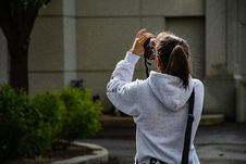Free Photo Of Girl Holding Dslr Camer And Taking Photo Stock Photography - 116984512