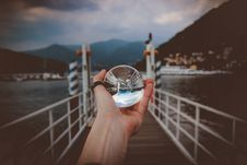 Free Person Holding Clear Glass Ball Stock Photography - 116984562