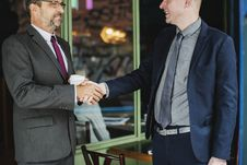 Free Two Men Wearing Suit Jackets Doing Hand Shake Royalty Free Stock Photo - 116984565