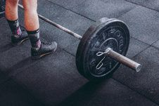 Free Person Standing Near Black Barbell Royalty Free Stock Photos - 116984638