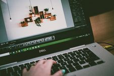 Free Selective Focus Photo Of Turned On Dell Laptop Stock Photography - 116984642