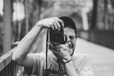 Free Man Holding Canon Dslr Camera Taking Picture Royalty Free Stock Photo - 116984645