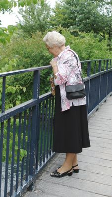 Free Senior Lady Looking Into River Royalty Free Stock Photo - 1174625