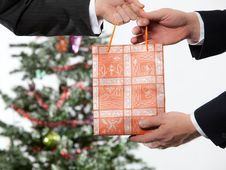 Free Business Man Receiving A Christmas Gift Royalty Free Stock Images - 11704389