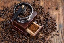 Coffee Mill On Rustic Wooden Plank Background And Roasted Coffee Beans Stock Photography