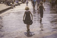 Free Grayscale Photo Of Two Woman Walks On Bricks Pavement Front Of People At Daytime Stock Photo - 117112360